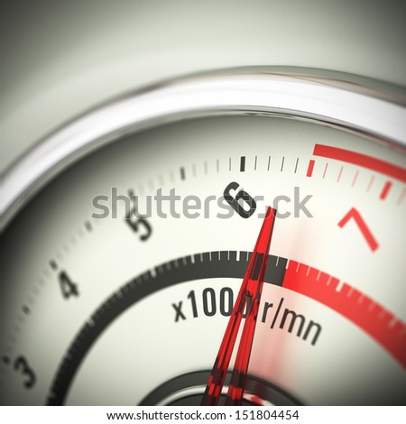 Close up of a tachometer with blur effect and the needle pointing just below the red limit