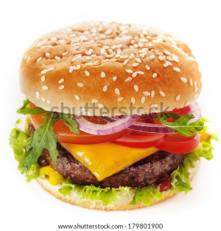 Close-up of a tasty cheeseburger made of green salad and ground meat patty topped with sliced tomato, onion, cheese, parsley and sweet ketchup, placed inside a sliced hamburger bun with sesame - stock photo