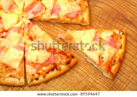 Close up of a tasty pizza with ham and cheese. - stock photo