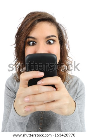 Close up of a teenager addicted to the smart phone isolated on a white background          - stock photo