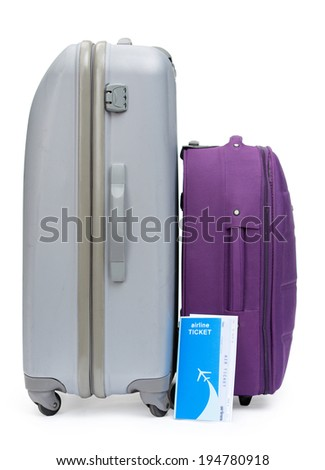 Close up of a ticket and two suitcases for traveling, isolated on white - stock photo
