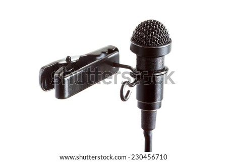 Close-up of a tie-clip microphone with a white background - stock photo