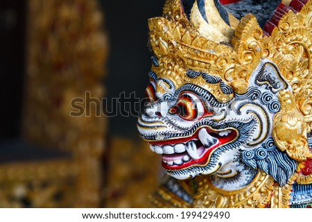 Close up of a traditional Balinese God statue in Bali temple - stock photo