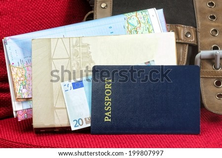 Close up of a traveling documents- passport, ticket, map and money.