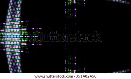 Close up of a TV screen display with pixels forming an abstract digital pattern.
