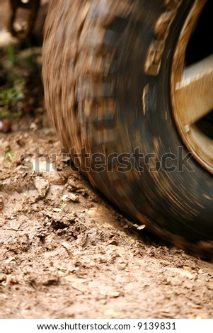 Close up of a tyre on an off road vehicle in motion.