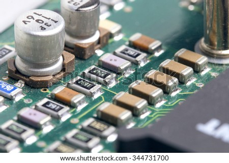 Close up of a used and dirty plate of electronic components - stock photo