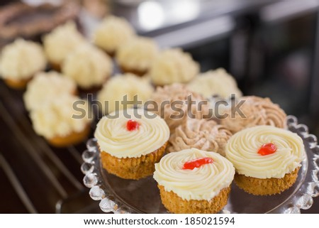 Close-up of a variety of different cakes and pastries at coffee shop - stock photo
