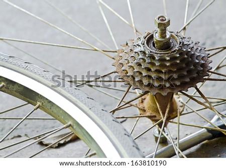 Close up of a very dirty bicycle of rear sprocket wheel and hub - stock photo
