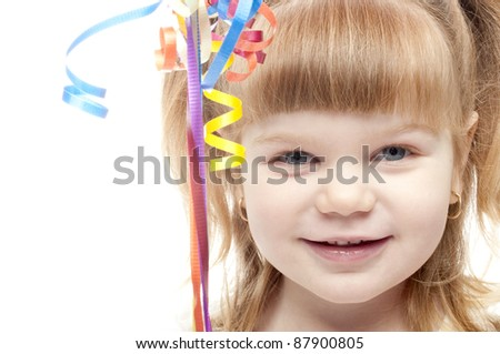 close up of a very happy girl, balloon strings in front
