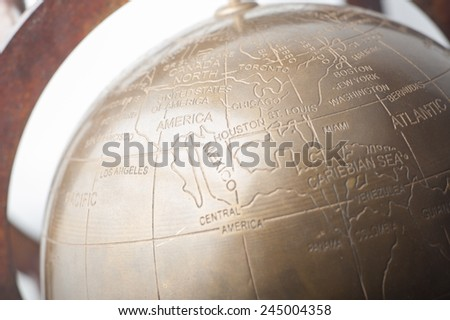 Close up of a vintage copper desk globe showing america continent - stock photo