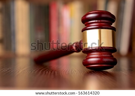 Close-up of a vintage gavel, on blurred background, symbol of impartiality and rightness, judicial decisions, closed cases and justice - stock photo