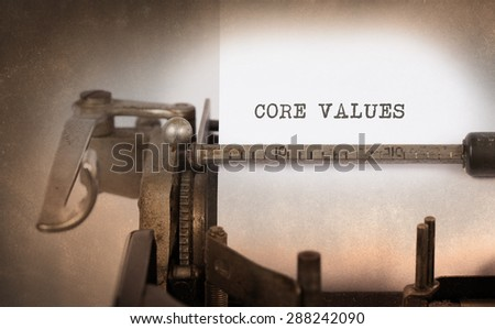 Close-up of a vintage typewriter, old and rusty, core values - stock photo
