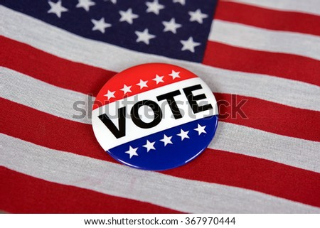 close up of a voting pin on an American flag - stock photo