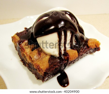 Close up of a waffle pancake with chocolate ice cream - stock photo
