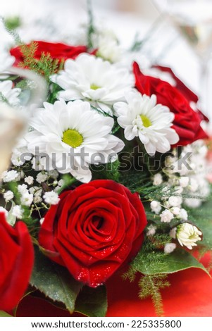 close up of a wedding bouquet with red roses - stock photo