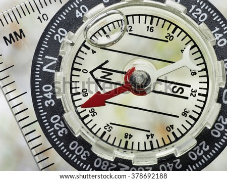 Close Up of a well used Compass Face With Shallow Depth Of Field - stock photo