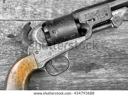 Close up of a western six shooter pistol in black and white. - stock photo