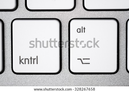 Close up of a white, gray computer keyboard. Focus on kntrl and alt. - stock photo