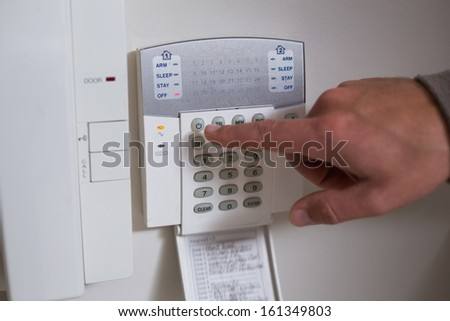 Close up of a white wall mounted entry phone system