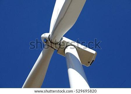 Close up of a wind turbine in operation.