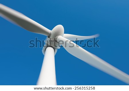 Close up of a wind turbine producing alternative energy - stock photo