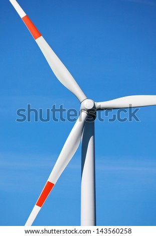 Close-up of a wind turbine with red marks on the wings - stock photo