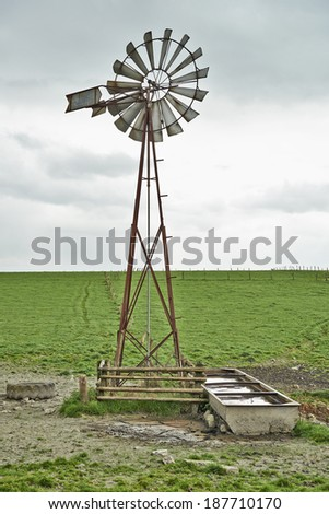Close-up of a windmill and cloudy sky - stock photo