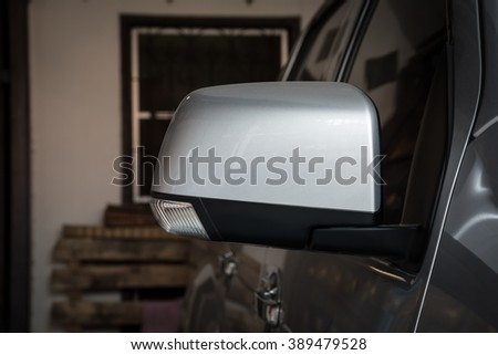 Close up of a wing mirror of car