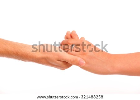 Close-up of a woman and a man holding hand in hand on a white background