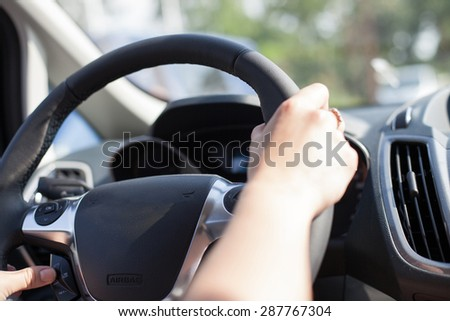 Close up of a woman driving
