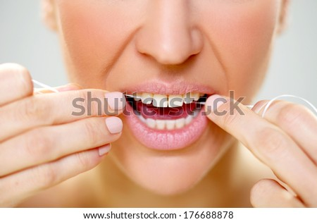 Close-up of a woman flossing 3