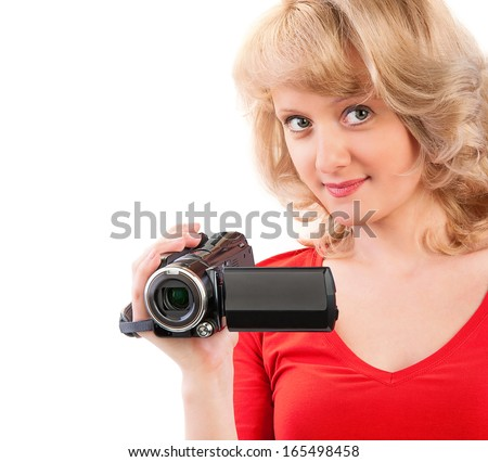 Close-up of a woman holding a home video camera - stock photo