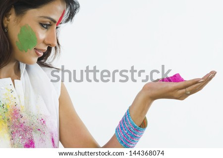 Close-up of a woman holding Holi colors