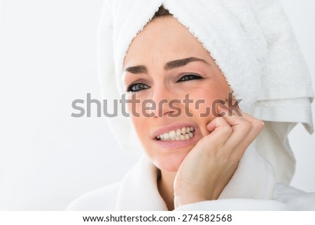 Close-up Of A Woman In Bathrobe Suffering From Toothache - stock photo