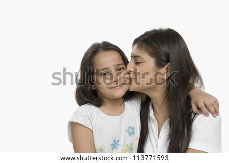 Close-up of a woman kissing her daughter