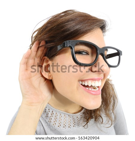 Close up of a woman listening with her hand in the ear isolated on a white background                - stock photo