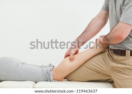 Close-up of a woman lying while being massaged in a room