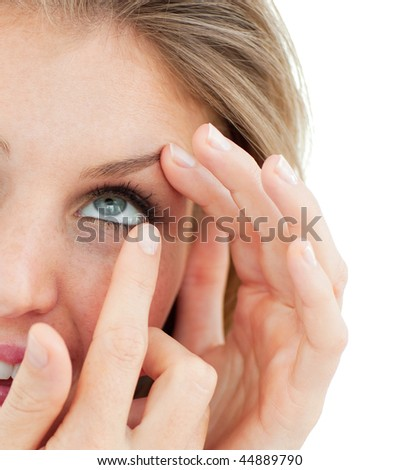Close-up of a woman putting a contact lens isolated on a white background
