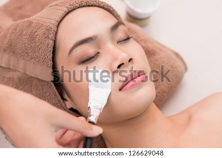 Close up of a woman's face having face mask - stock photo