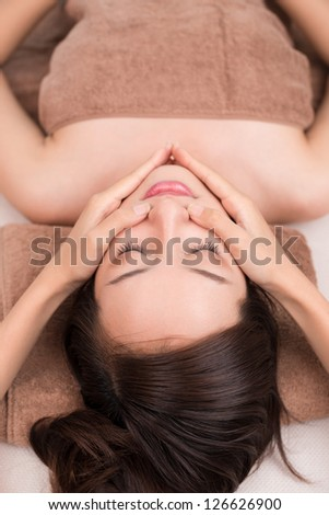 Close up of a woman's face having massage - stock photo