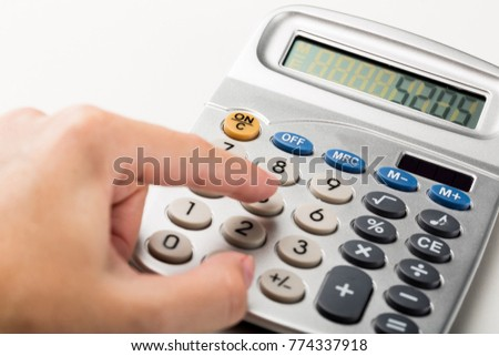 Close-up of a Woman Using Calculator