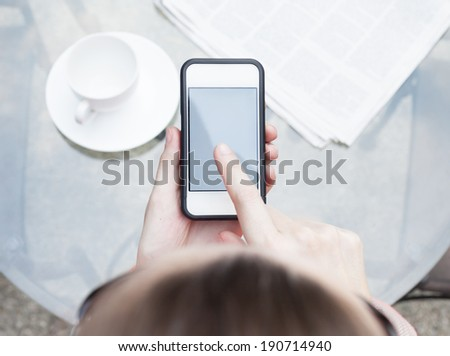 Close up of a woman using mobile smart phone outdoor - stock photo
