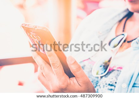 Close up of a woman using mobile smart phone/selective focus