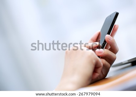 Close up of a woman using smartphone - stock photo