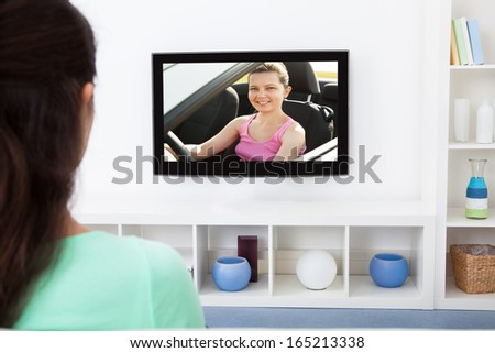 Close-up Of A Woman Watching Television At Home - stock photo