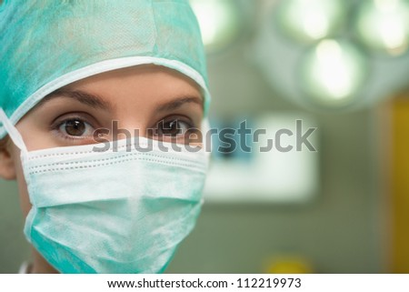 Close up of a woman wearing surgical gear in a surgical room