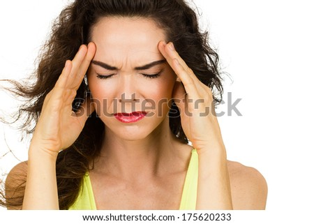 Close-up of a woman with a bad headache or migraine. Isolated on white.