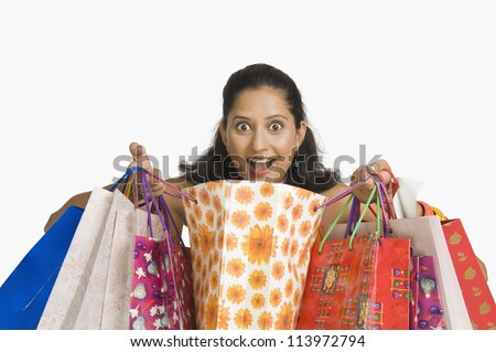 Close-up of a woman with shopping bags - stock photo