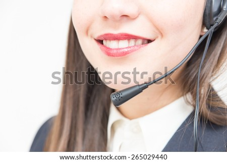 close up of a woman working in a office with headset. concept about business, office, call center, technology, customer care and people - stock photo